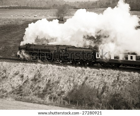 VINTAGE STEAM TRAIN WITH IDENTIFICATION MARKINGS REMOVED PHOTOGRAPHED IN BLACK AND WHITE WITH SEPIA TINT - stock photo