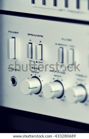 Vintage Stereo Amplifier Frontal Panel Control Knobs Angled View Closeup - stock photo