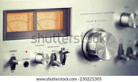 Vintage Stereo Audio Amplifier Front Panel Volume Knob Closeup - stock photo
