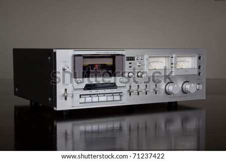 Vintage Stereo Cassette Tape Deck Recorder on the dark background - stock photo