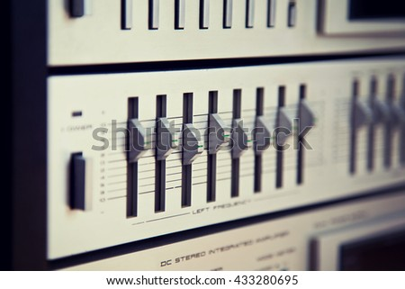 Vintage Stereo Equalizer Frontal Panel Control Knobs Angled View Closeup - stock photo