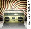 Vintage stereo player in retro spiral background. - stock photo