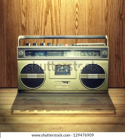 Vintage stereo player in wooden background.