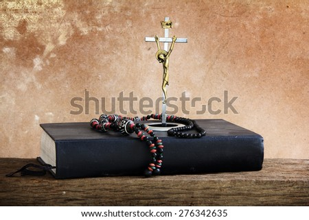 Vintage still life crucifix and Bible - stock photo