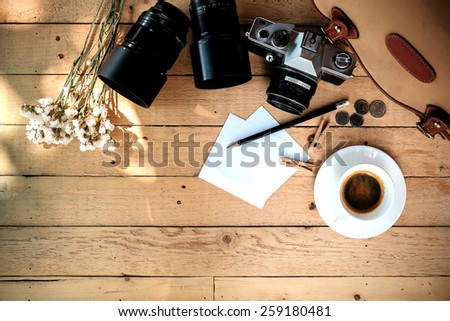 Vintage still life details, cup of coffee,paper note and pencil - stock photo