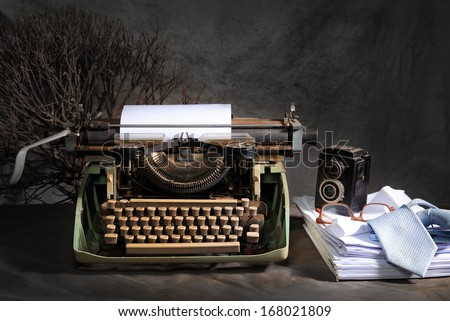 Vintage still life in reporter concept with old typewriter and retro twin lens reflex camera - stock photo