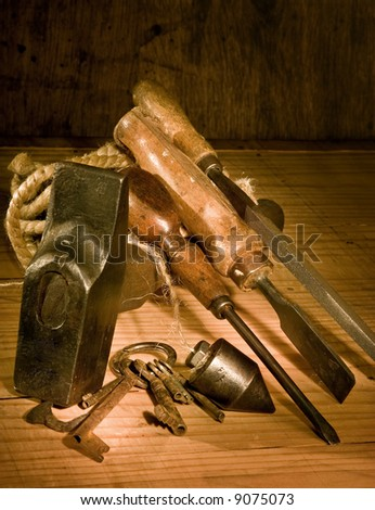 Vintage still-life of rusty grungy tools and rope - stock photo