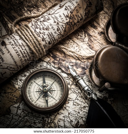 vintage  still life with compass,sextant and old map. - stock photo