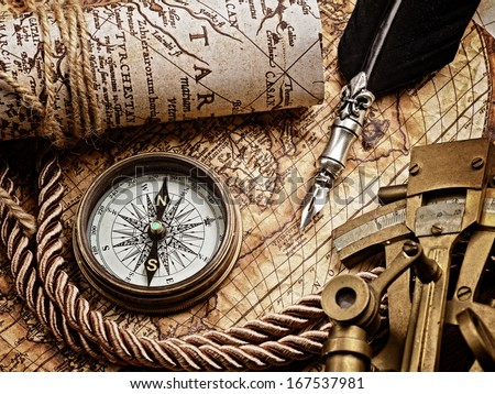 vintage still life with compass,sextant and old map.map  - stock photo