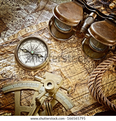 vintage still life with compass,sextant and old map .map used for background is in Public domain.  - stock photo