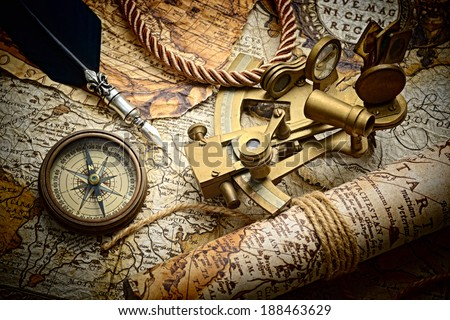 vintage still life with compass,sextant and old map.map used for background is in Public domain. Map source: Library of Congress. Country: Belgium Year: 1570. Author: Abraham Ortelius (1527-1598)  - stock photo