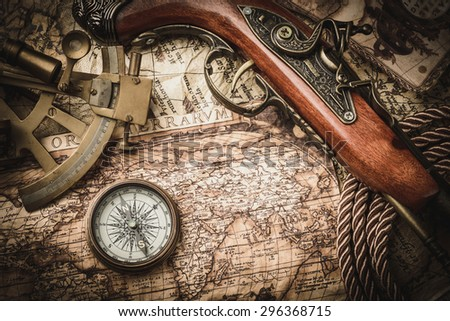 vintage  still life with compass,sextant and pistol  - stock photo