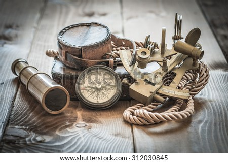 vintage still life with compass,sextant and spyglass  - stock photo