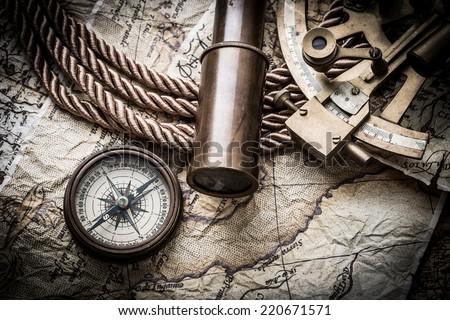 vintage  still life with compass,sextant spyglass and old map - stock photo
