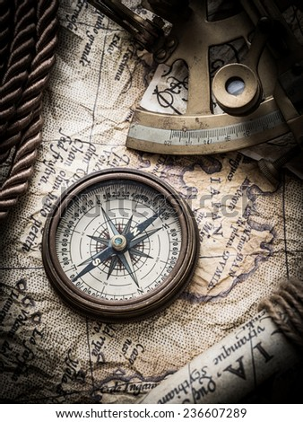 vintage  still life with compass,sextant spyglass and old map.map of the 1570. Author: Abraham Ortelius (1527-1598)  - stock photo