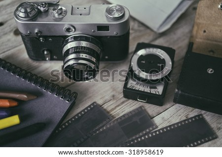 Vintage still-life with old retro cameras on a wooden table - stock photo
