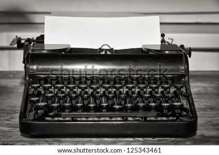 Vintage still life with old typewriter - stock photo