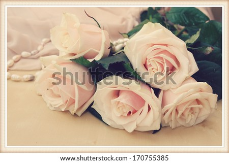 vintage still-life with pink roses