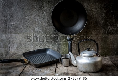 Vintage still life with small classic kettle for camping - stock photo