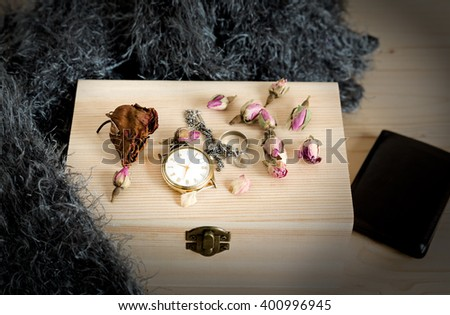 Vintage still life with watch on a wooden box - stock photo