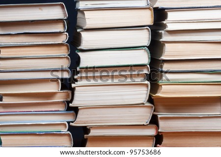 Vintage stock books on dark  background - stock photo