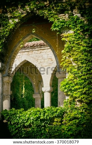 Vintage Stone Gothic Arc in Greenery - stock photo