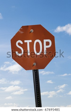 VINTAGE Stop sign against vast blue sky - stock photo