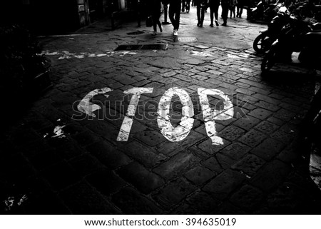 Vintage stop sign black and white - stock photo