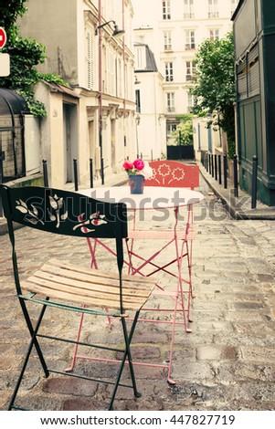 Vintage street cafe in Paris - stock photo
