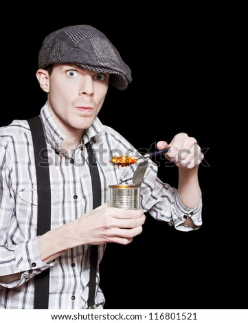Vintage Street Peasant Boy In Flat Cap Eating Baked Beans From A Can In A Depiction Of The Great Depression - stock photo