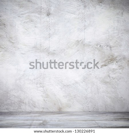 Vintage stucco wall and floor in industrial building - stock photo