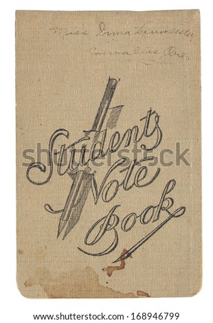 Vintage student notebook with stains, handwriting, fabric, with clipping path - stock photo