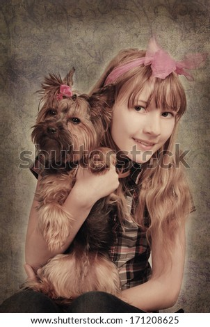vintage studio portrait of beautiful young girl with her yorkshire dog