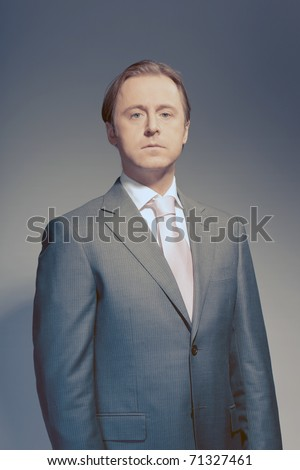 Vintage studio portrait of serious young business man. Power. Boss. Proud. Concentration. Ambition. - stock photo