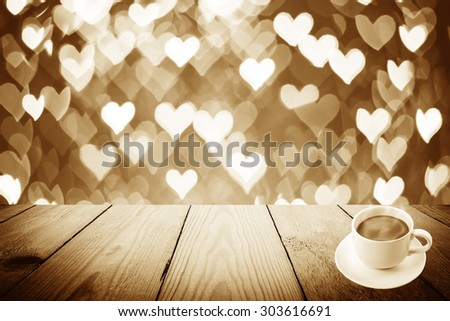 Vintage style - Abstract Black and White bokeh of light and coffee cup and wood background - stock photo