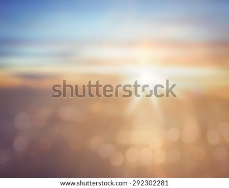 Vintage style. Abstract blurred textured background: brown orange blue patterns. Blurred nature background. Sandy beach backdrop with turquoise water and bright sun light. Summer holidays concept. - stock photo