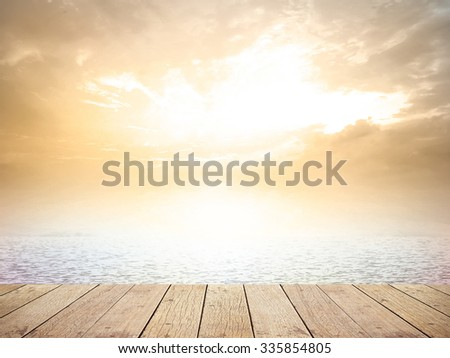 Vintage style. Abstract Nature background: yellow pink blue patterns. Wooden paving and the beach backdrop with turquoise water and bright sun light. Summer holidays concept. - stock photo
