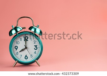 Vintage style alarm clock with copy space for text. - stock photo