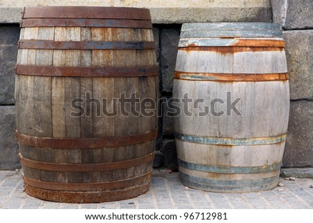 Vintage style barrels against a wall - stock photo