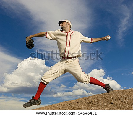 Vintage style baseball pitcher throws ball. Square shot. - stock photo