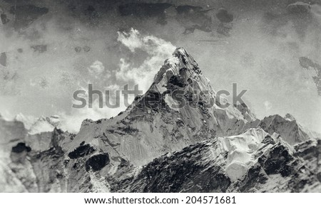 Vintage style black and white image of Mt. Ama Dablam in the Everest Region of the Himalayas, Nepal. - stock photo