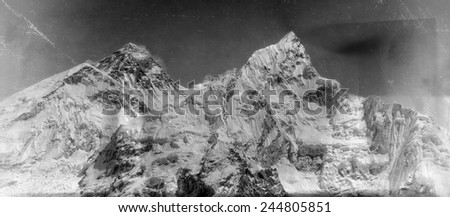 Vintage style black and white image of the world's highest mountain, Mt Everest (8850m) and Mt. Nuptse in the Himalayas, Nepal. - stock photo
