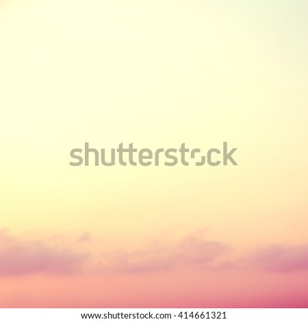 Vintage style blur abstract background natural tranquil serene evening sea beach sunset tropical holiday soft cloud sky edge frame yellow gold warm color tone blank empty space for text message  - stock photo