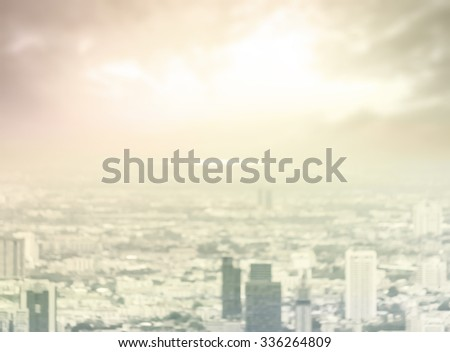 Vintage style. Blurred aerial view of Bangkok skyline on amazing beauty golden warm light sunrise. Beautiful hotel, resident of Bangkok city, Thailand, Asia. Insurance, Investment, industry concept. - stock photo