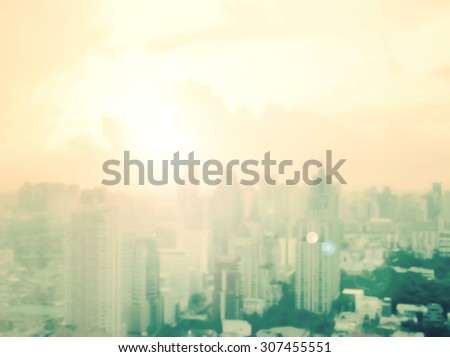 Vintage style. Blurred sunrise, night over city background with circle light. Blur big city backgrounds concept. World City Day concept. - stock photo