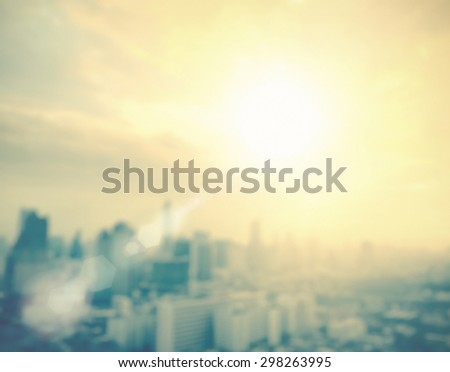 Vintage style. Blurred sunrise over city background with bokeh light. blur background concept. World City Day concept. - stock photo
