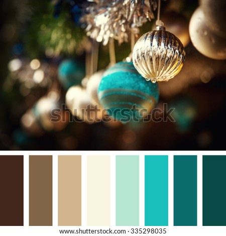 Vintage style Christmas decorations of glass baubles and tinsel. In a colour palette with complimentary colour swatches. - stock photo