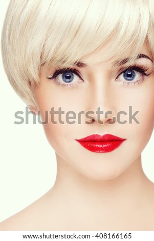 Vintage style close-up portrait of young beautiful blond girl with winged eye make-up and red lipstick - stock photo