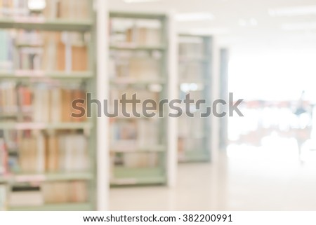 Vintage style color tone blurred abstract background of aisle of data collection shelves in school library: Blurry interior perspective view of a study room with tables, chairs and stacks of books - stock photo