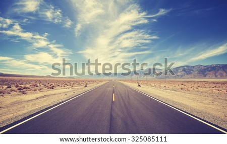Vintage style country highway in USA, travel adventure concept. - stock photo